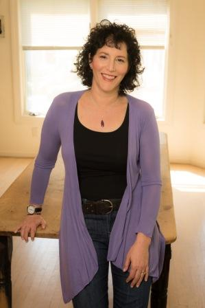 Photo of Michelle Brafman leaning against table